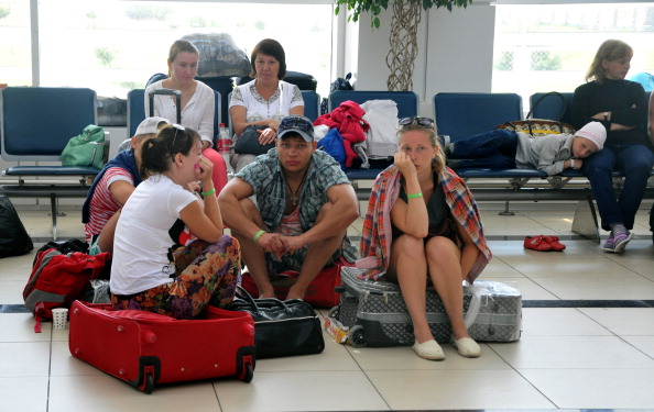 ANTALYA, TURKEY - AUGUST 4 :  A group of 30 Russian tourists wait at Antalya Airport in Turkey on August 4, 2014  after their Russian tour company went bankrupt. The tour group, who arrived in Antalya, Turkey on August 2 for a ten day holiday in one of Turkey's popular beach holiday destinations, could not be accommodated in their hotel and were left stranded at the airport. (Photo by Suleyman Elcin/Anadolu Agency/Getty Images)